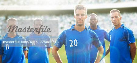 Soccer team standing on field