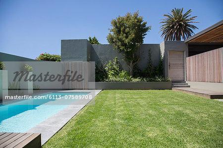 Modern lap pool in backyard