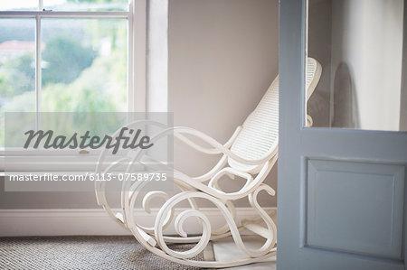 Antique rocking chair in corner