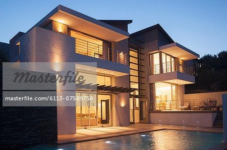 Modern house illuminated at night