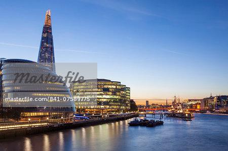 London skyline at dusk including the GLA building, HMS Belfast and the Shard, taken from Tower Bridge, London, England, United Kingdom, Europe