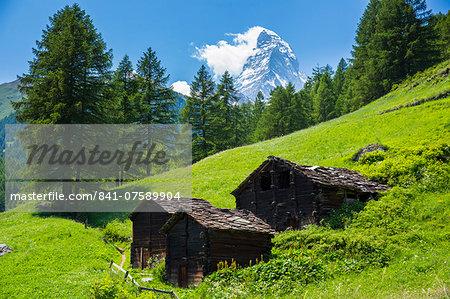Chalet barns below the Matterhorn mountain in the Swiss Alps near Zermatt, Valais, Switzerland, Europe