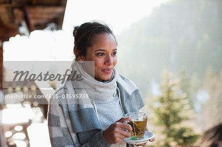 Portrait of smiling woman drinking tea