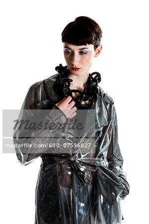 Portrait of Young Woman wearing Rain Jacket and Modern Jewellery, Studio Shot