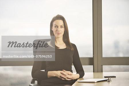 Portrait of businesswoman at office desk