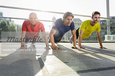 Runners doing push ups, Munich, Germany