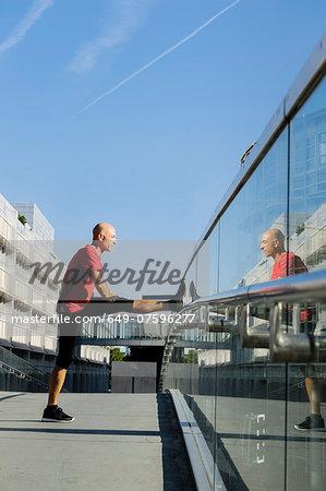 Runner stretching, Munich, Germany