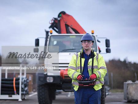 Portrait of Emergency Response Team worker training with truck crane