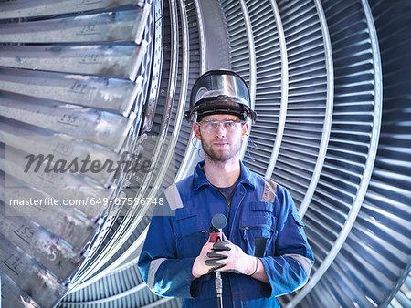 Portrait of apprentice engineer in steam turbine repair workshop