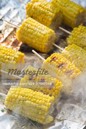 Grilled corn on the cob on aluminium foil