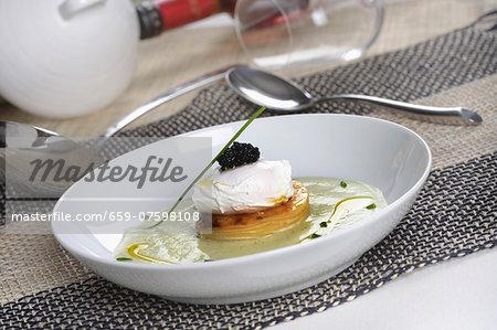Poached eggs with potato terrine