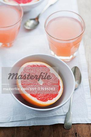 Grapefruit juice and half a grapefruit