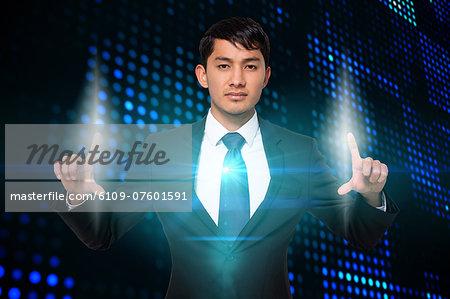 Serious businessman touching lights