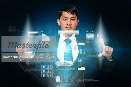 Serious businessman touching interface