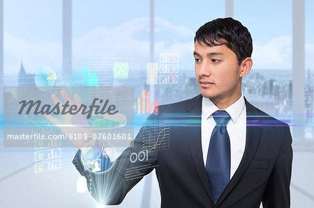 Asian businessman touching interface