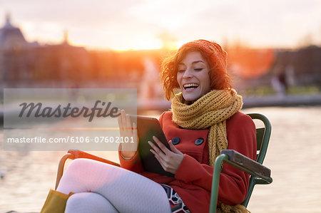Woman using digital tablet in Jardin des Tuileries
