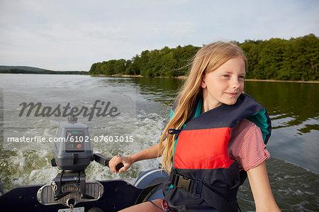 Teenage girl on boat, Skane, Sweden