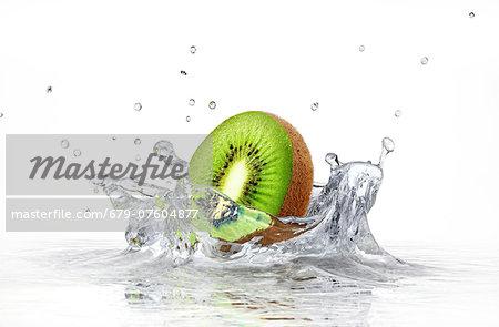Kiwi splashing into water, computer artwork.
