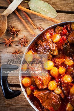 Stifado (spiced stew with pork and onions, Greece)