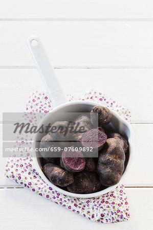 Vitelotte potatoes in a saucepan