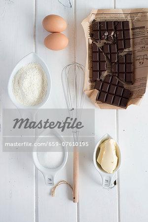 Baking Ingredients; Bowl of Flour; Eggs; Whisk