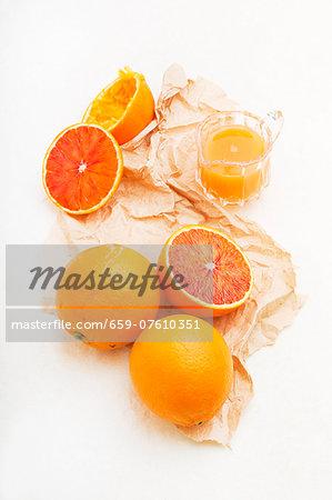 Sicilian half blood oranges: whole, halved and juiced