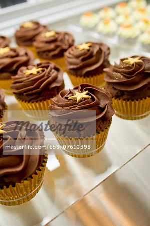 Chocolate fudge cupcakes decorated with stars