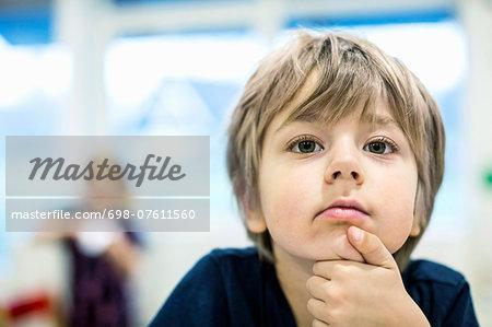 Little boy looking away in kindergarten