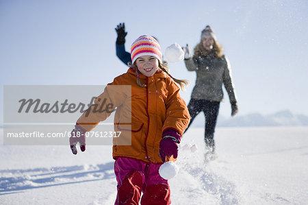 Family throwing snowballs