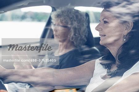 Senior female friends on road trip