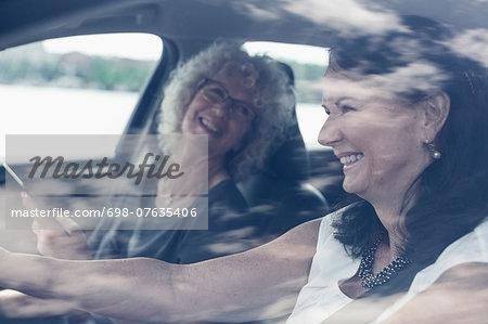 Happy senior women enjoying road trip