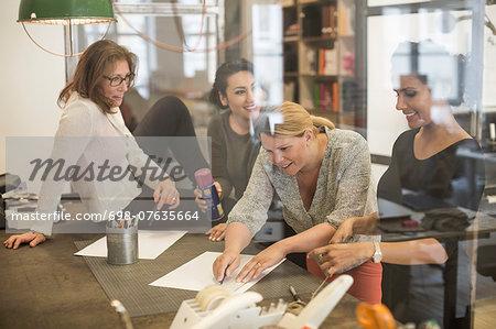 Creative businesswomen working together in office