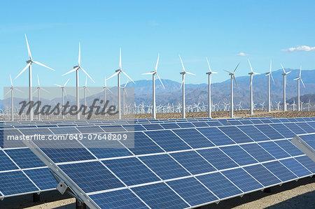 Photovoltaic solar panels and wind turbines, San Gorgonio Pass Wind Farm, Palm Springs, California, USA. This solar installation has a 2.3 MW capacity