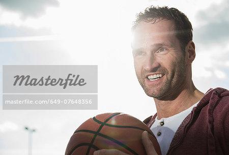 Basketball player holding basketball