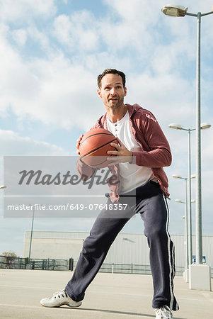Basketball player about to throw basketball