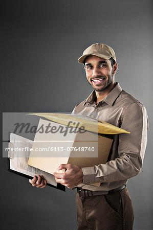 Portrait of confident deliveryman