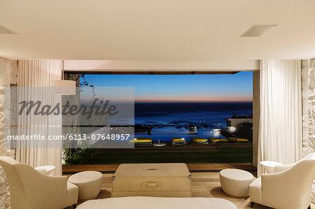 Modern bedroom overlooking ocean at night