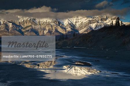 Reflection of Rocky Mountains in Jasper Lake, Jasper National Park, Alberta, Canada