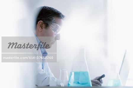 Scientist looking at smartphone