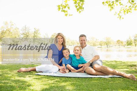 Happy family at lakeside, Newport Beach, California, USA