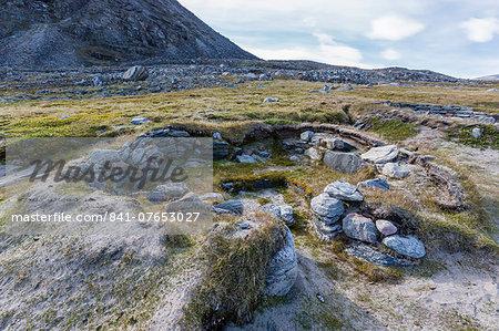 Thule semi-subterranean winter home sites in Fechem Bay, Baffin Island, Nunavut, Canada, North America