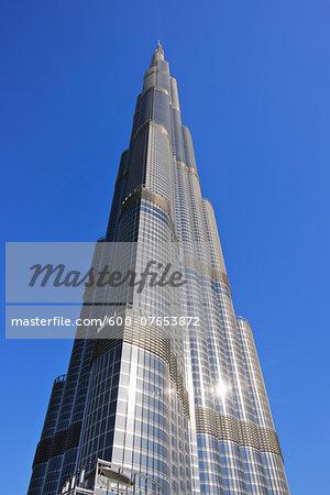 Looking up Sun Reflecting off Burj Khalifa with Blue Sky, Dubai, United Arab Emirates