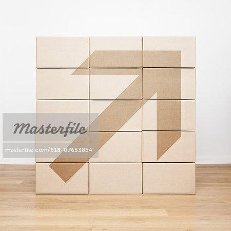 Arrow printed on cardboard boxes