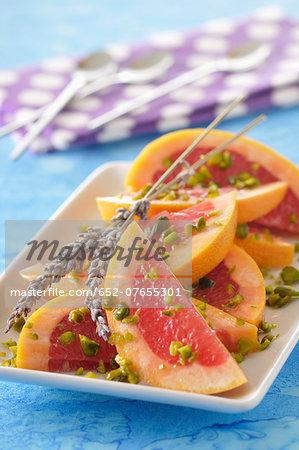 Pomelos with pistachios and lavander oil