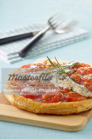 Sardine and tomato tatin tart