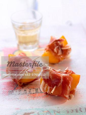 Apricots and Serrano ham bites