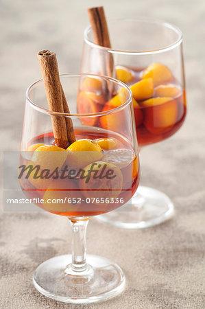 Cinnamon-flavored kumquats in red wine