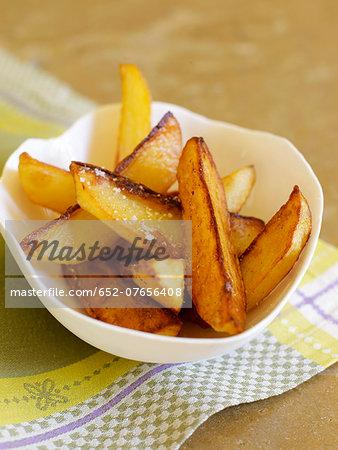 Fried potatoes with coarse salt