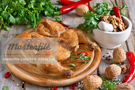 Chicken tabaka, traditional recipe of Georgian cuisine. Selective focus.