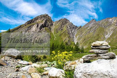 stone figure in the Alps